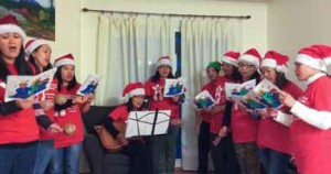 Members of Babae: Council of Filipina-Canadian Women while carolling.