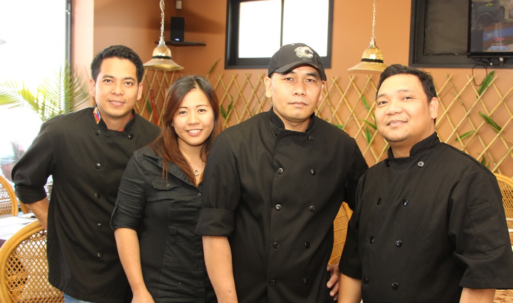 Four Filipino partners dream of big things for their new restaurant, Adobo Experience (left to right): Jeffrey Angeles, Eva Parangalan, George Maliwat, and Ronaldo Nunag.