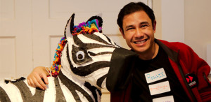 "Reg Tiangha at the Awesome Calgary ""Meat-Filled"" Zebra Piñata Party initiative inspired by a grant awarded by The Awesome Foundation - Boston."