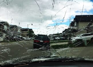 Hailstorm damage on a car windshield
